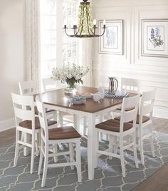 Colors Buttermilk 5pc Pub. Collection includes four buttermilk pub chairs with spice seat. Also available in espresso and black finish.