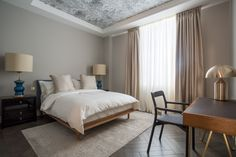 Taupe bedroom with parquet and ceiling print. http://studiomillsdesign.com