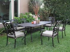 """CBM Outdoor Cast Aluminum Patio Furniture 7 Pcs Dining Set G1 CBM1290 by Dining Set. $1499.00. Table dimensions: 83"""" L x 42"""" W x 29"""" H . Table weight: 88 lbs.Assembly required, tools included.. IF YOU HAVE ANY QUESTIONS PLEASE CLICK ON CBM1290 then RETURNS.. Chairs dimensions: 28"""" D x 24"""" W x 38"""" H . Chair weight: 20 lbs. (each). Color: Antique Black Brown finish, Includes: 6 Arm chairs and 6 Free Cushions and  1 table. Made of genuine cast aluminum with Powder ..."""
