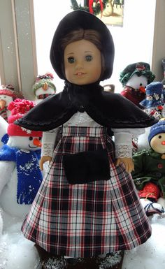 Lovely Victorian Era Outfit for American Girl Dolls~ Blouse made from a 100% Cotton Martha Pullen Batiste with lots of Victorian detailing:  three embroideries, insertion and entredeux; a 5-panel Plaid Skirt, a 5-panel Underskirt, along with a Black Velveteen Caplet, Muff and Bonnet trimmed in black French lace, by RebeccasHeirlooms via Etsy