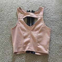 night / going out crop top tan / leather zipper on back, perfect for going out / girls night out. never worn, too small, perfect condition Charlotte Russe Tops Crop Tops