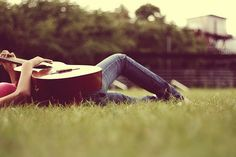 with guitar on grass
