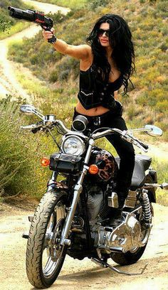 Sexy badass woman on motorbike with gun.