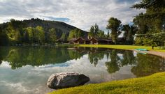 Simply Spectacular in Indian Springs ~ Set on 13+ acres of lush landscaping with Teton views, this exquisitely rustic home and guest home offers exceptional features that will exceed your expectations as well as Indian Springs Ranch's private amenities. $6,600,000. Jackson Hole, Wyoming. http://spackmansinjacksonhole.com (13-1774)