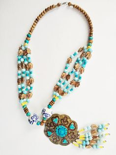Multi Color Tribal Necklace With A Big Metallic Pendent And Crystal Beads