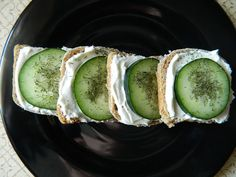 Mini Cucumber Sandwiches, made with ranch dressing mix, cream cheese, and sour cream. You can also use French bread. These are delicious!