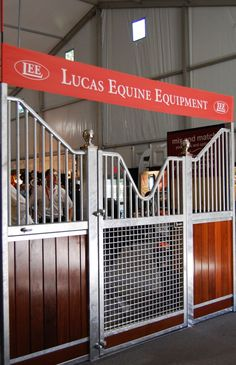 Super tough hot-dipped galvanized horse stall with pretty ipe hardwood and silver finials.