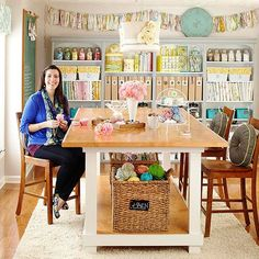 This craft room has a lot of visual appeal, not to mention a 4' x 8' table!  [this one is counter-height; I prefer table-height]  Drooling!