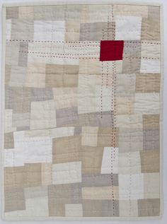 The red quilting stitches