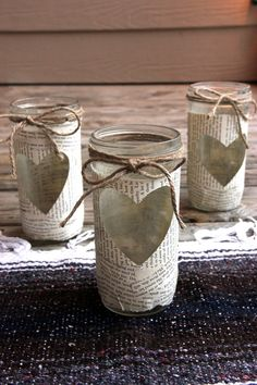 These mason jars are covered in worded paper with a heart cut-out. This sweet jar is topped with a hemp bow! It would be a perfect decoration for any rustic or country wedding. These decorations are hand made. They would be great for candles, flower vases or simply by themselves!