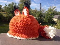 Fox tail cap. Crocheted fox hat with two fox ears and a fluffy tail in the back. What's the fox say?