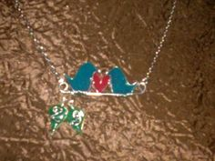 Blue and Red Personalized Love Birds Necklace made from Wire and Resin with initials in dangling leaves. Hand made by request $20.00 any 3 combination of colors. Contact: bojosmoms creations on facebook.