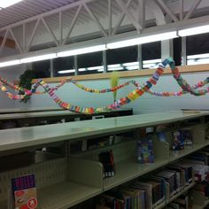 """Linked through Literacy"" kids spent a week visiting the Library and writing down the names of their favorite books on prices of paper.  The class with the longest ""chain link"" won a special prize!  They LOVED it, and it created a nice decoration for the ""candyland book fair""!"