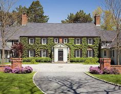 CURB APPEAL – another great example of beautiful design. Ivy looks enchanting on this brick home.