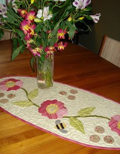Lovely table runner in a different shape, and I do love the bee among the flowers...I just found out this is called Wild Rose by Pat Sloan...She also has a lap quilt in the same pattern...