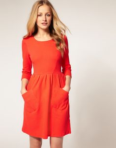 asos: fit and flare design, scoop neckline, bracelet length sleeves, fitted bodice, highwaist line, full gathered skirt, with two slanted patch pockets, and en exposed zip to reverse, in a waffle weave cotton finish...