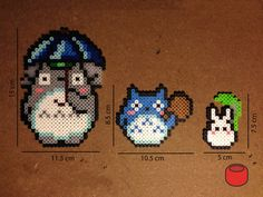 Totoro magnets made from perler beads. Character options include: A big totoro holding an umbrella A medium totoro holding a sack A little totoro holding