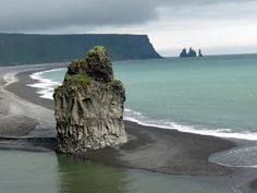 View from the cliffs at Dyrhólaey onto the beach below, looking out toward Reynisfjara. / Pam on the Map: Iceland