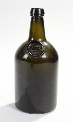 Lot 213 - Turned moulded squat cylinder olive green glass bottle with seal by J & W W Wagner. c1860. 26cm