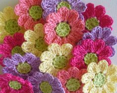 A collection of 12 thicker cotton crochet embellishments ready to add to purses, hats, pillows, quilts, denim. ** Crocheted in 100% size 3 cotton crochet thread - heavier and sturdier than flowers crafted in size 10 thread. This set includes 12 flowers with rounded petals - each flower is approximately 1 1/2 inches. The petals are Maize Yellow, Coral, Tangerine, Natural. The centers are Tan. ** Please remember monitors vary in showing colors. If you are looking for smaller flower...