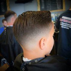 slick haircut with a quiff (rear view)