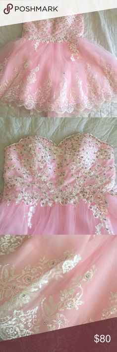Pink formal dress This dress is a light pink color with a white overlay. It has only been worn once. It has built in cups so you don't have to wear a bra. vilavi Dresses Prom