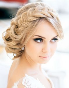 The milk maid braid is everything! Whether your going for traditional style, a wispy bohemian feel, or anything in between, variations of this braid are just to die for. Ask your stylist to find the perfect extension piece or braid to match your hair that can be added to your look. See more amazing wedding hair ideas here.