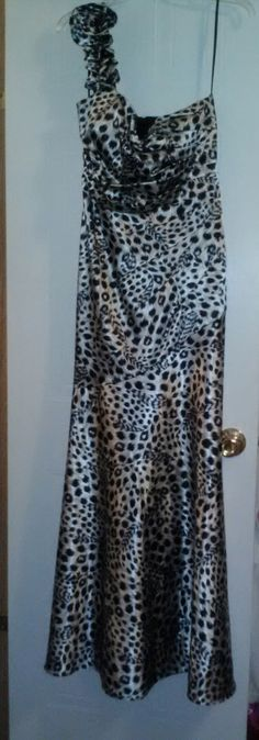 Prom/Formal Dress in Shaunya's Garage Sale in Hickory , NC for $50.00. Cheetah Print, one shouldered, size 11/12. wore it one time.