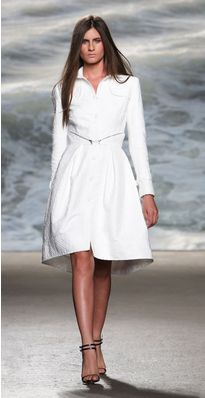 The classic trench gets a makeover with this pure white textured jacquard long sleeve trench coat. This Rolando Santana creation is a luxurious coat that can take you all the way from the office to Labor Day in the Hamptons. Girl Fashion, Fashion Show, Womens Fashion, All About Fashion, Fitted Bodice, How To Feel Beautiful, Amazing Women, Beautiful Women, Designer Collection