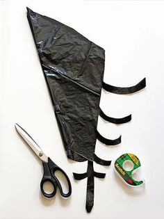 Begin by laying a trash bag out flat. Trim off the sides and bottom so you're left with two big rectangles of plastic. Cut each piece into an approximate square (eyeballing it is fine). Fold one of the squares in half diagonally to form a triangle. Fold that triangle in half two more times.
