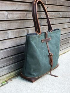 love this bag  waxed canvas bag carry all/tote bag with oiled leather bottem UNISEX. $179.00, via Etsy.