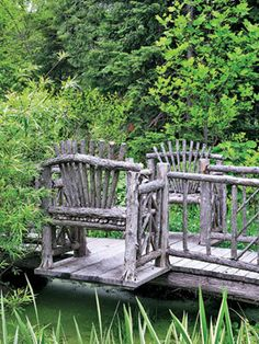 Rustic cedar benches as part of a pond bridge