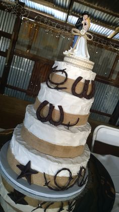 Country Wedding Cake Decorated with Burlap Bands, Fondant Barbed Wire, Horse Shoes, and Texas Star
