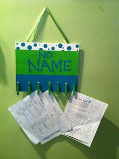 This could definitely be an easy and inexpensive DIY project. A blank board, some fun paint, and some clothespins! Great idea!!  >This one is called The No Name Board. $8.00, via Etsy.