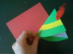 Buddy the Elf themed party invites. Just a blank card with the sides cut to make it look triangular,yellow card stock, and red feathers for buddy's hat!