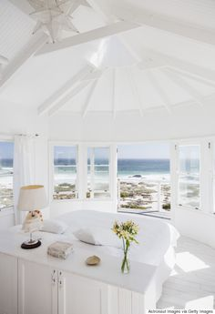 Replace your colored linens with whites for a beachy-clean look