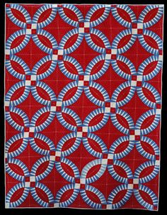"""Patriotic Rings quilt, in:  """"Quilt As Desired"""" by Mary W. Kerr.  The vintage pickle dish quilt top was custom quilted; check out the  feather design."""