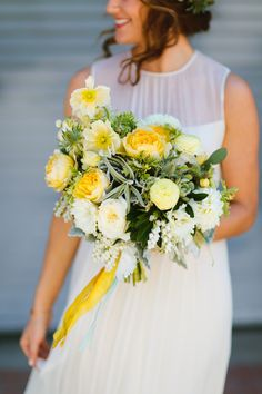 yellow spring bouquet - photo by Jackie Wonders http://ruffledblog.com/luce-loft-wedding-with-a-citrus-color-palette #weddingbouquet #flowers #bouquets