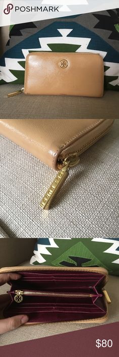 Tory Burch tan and purple wallet w gold hardware Tory Burch wallet, tan Robinson patent leather with a beautiful purple interior. Interior coin purse. A few scuffs but still very useable! Tory Burch Bags Wallets