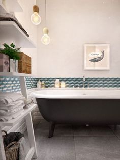 kids bath, floor, white plank wall, blueish design tile above, black vanity, wood wicker basket and trash and accessories, black lights