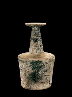 OBJECT NAME  Cylindrical Bottle PLACE MADE  probably Persia DIMENSIONS  Overall H: 22.7 cm, Diam (max): 13.5 cm DATE  900-1099