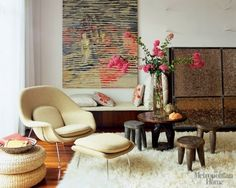 Really adore this room with the womb chair, fluffy rug and floral arrangement.  Check out the other womb chair photos, and the article, on Apartment Therapy.  Photo courtesy of Apartment Therapy and Elle Decor.