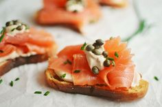 A gorgeous Smokey Salmon Crostini, perfectly posh, with a Gullah Gravy spiked whipped cream cheese that makes it insanely delicious!