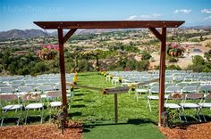Beautiful view behind ceremony on private estate terraced lawn. Sunflowers, arbor, wine country, DIY rustic chic wedding in Temecula