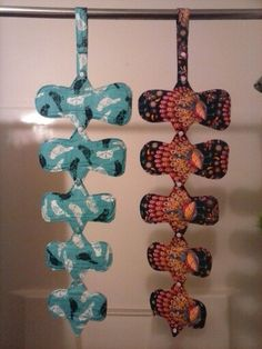 "Blue Birds and Peacocks Cloth Menstrual Pads Hanging From the Drying Snap Loop. Sizes 6""-10"""
