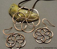 #Wire wrapped earrings and pendants. Interesting technique; binding a set of S-shaped wires together into a circular mandala-like shape.