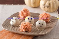 File these easy Halloween treats under ghoulishly delicious. These ghost truffles and pumpkins have chocolate centers that are a treat to bite into!