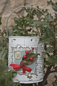 """Outdoors candle holder using an old tin can.  Fill a can with water and put it in the freezer.  When it is frozen, make holes using a hammer and nails - Economical way to make a """"Santas Runway"""" - Children love it"""