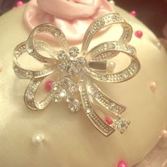 """Fashion Brooch Bow Adorable fashion brooch. silver with studded rhinestones. Approximately 2"""" wide. Used to wear to work during the holidays. Jewelry Brooches"""