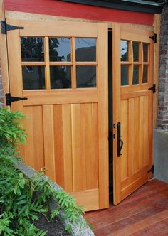 Swing-out doors from Real Carriage Doors offer true divided lights and functional hardware.